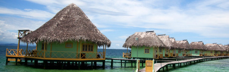 Punta Caracol's cabanas hover over the crystal waters of the Caribbean in Bocas del Toro