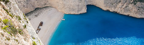 The Greek Isles offer secluded beaches and unspoiled coves like Shipwreck Beach